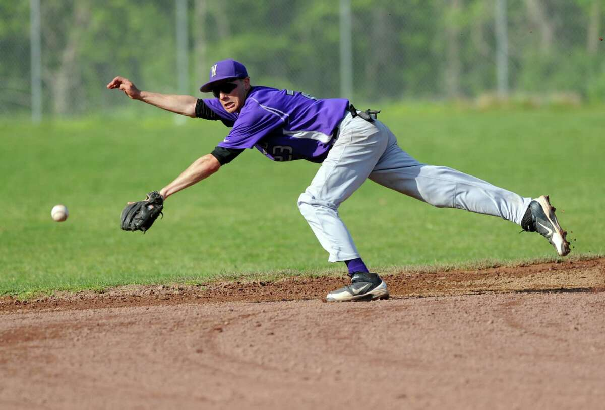 Westhill's Billy Murphy dives after the ball during Friday's baseball game against Staples at Westhill High School on May 4, 2012.