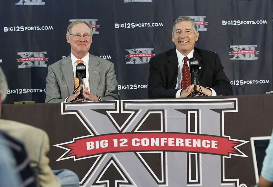 New Big 12 Conference Commissioner Bob Bowlsby, right, smiles at a news conference where he was introduced to the media at Big 12 headquarters  Friday, May 4, 2012, in Irving, Texas. At left is Oklahoma State University President Burns Hargis  (AP Photo/LM Otero) Photo: LM Otero, Associated Press