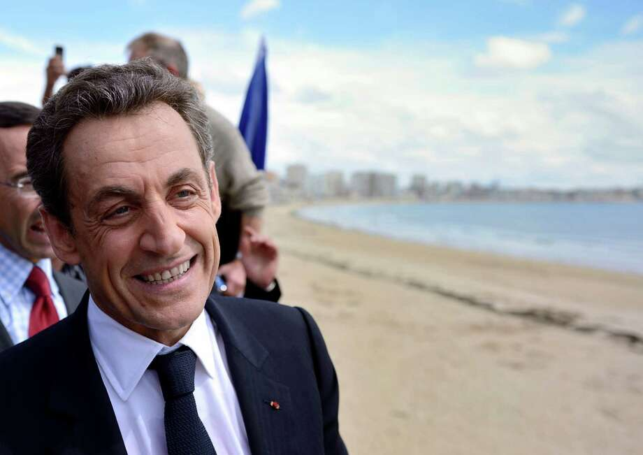 France's incumbent President and Union for a Popular Movement (UMP) party candidate for the French 2012 presidential election, Nicolas Sarkozy, strolls along the sea front after his last campaign meeting in Les Sables-d'Olonne, western France, Friday, May 4, 2012, two days ahead of the second round of the French presidential elections. (AP Photo/Erci Feferberg, Pool) Photo: Eric Feferberg / Copyright 2012 The Associated Press. All rights reserved. This material may not be published, broadcast, rewritten or redistribu