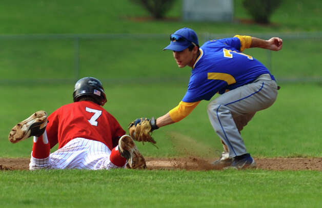 Seymour's #7 Frank Frosceno tags out Derby's #7 Raymond Kreiger as he tried to get back to second, during boys baseball action in Derby, Conn. on Friday May 4, 2012. Photo: Christian Abraham / Connecticut Post