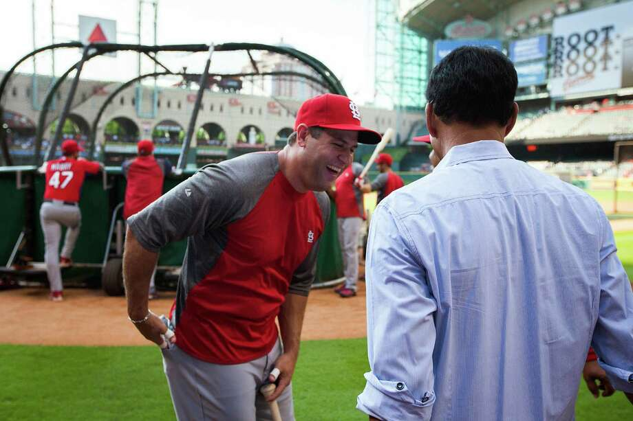 St. Louis Cardinals first baseman Lance Berkman laughs with former Houston Astros player and coach Jose Cruz during batting practice before facing the Houston Astros at Minute Maid Park on Friday, May 4, 2012, in Houston. Berkman, the former Astros player, is on the disabled list for the Cardinals. Photo: Smiley N. Pool, Houston Chronicle / © 2012  Smiley N. Pool