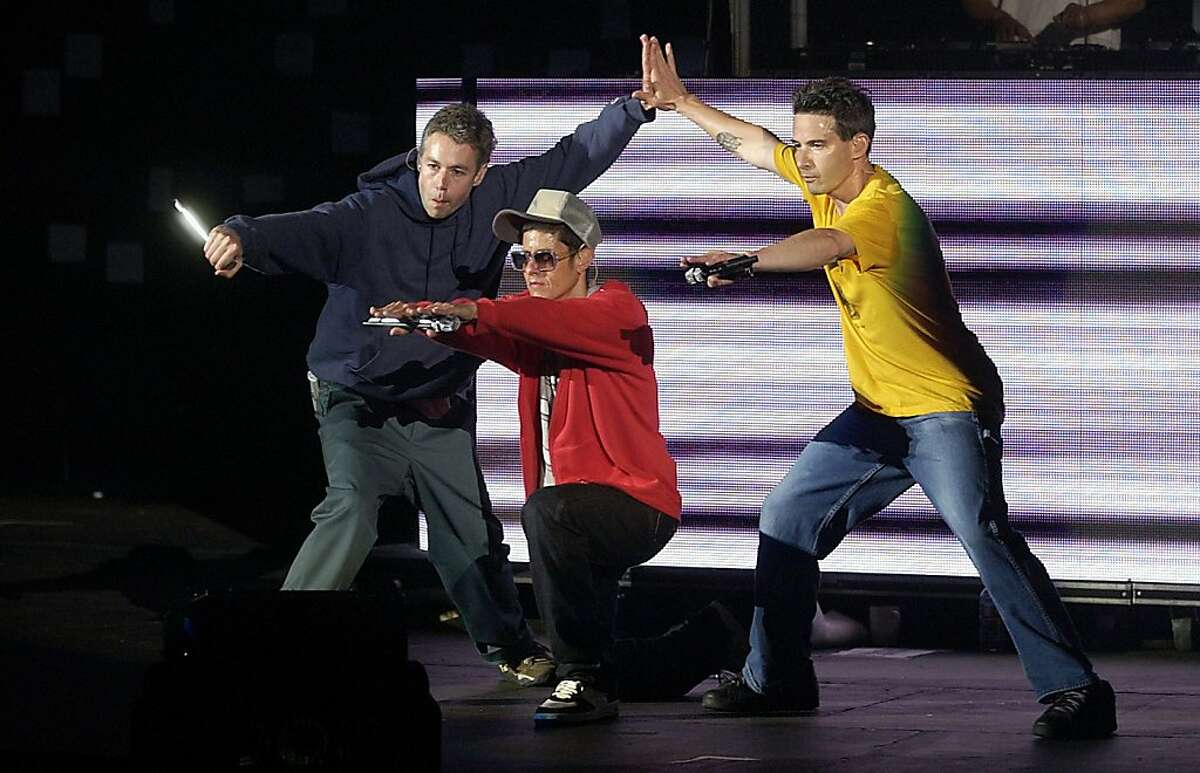 In this June 12, 2004 file photograph, the Beastie Boys perform during KROQ Weenie Roast at Verizon Wireless Amphitheater in Irvine, California. Adam Yauch, left, has died, Friday, May 4, 2012, according to Rolling Stone magazine. He was 47. (Christine Cotter/Los Angeles Times/MCT)