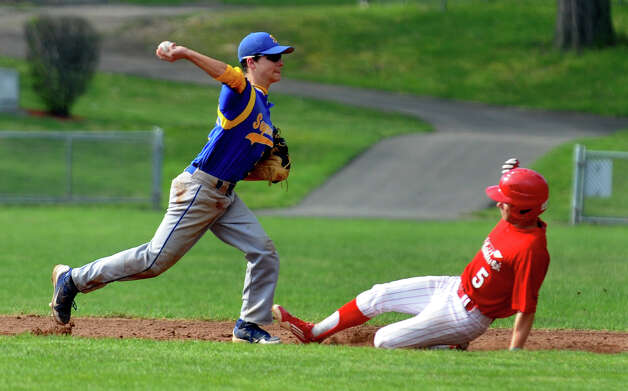 Seymour's #7 Frank Frosceno sends the ball to first after the out on Derby's #5 Nick LeMire, during boys baseball action against Seymour in Derby, Conn. on Friday May 4, 2012. Derby defeated Seymour 2-0. Photo: Christian Abraham / Connecticut Post