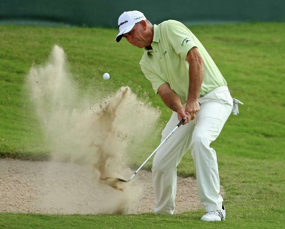 Tom Lehman blasts out of a greenside bunker on No. 18 during the first round of the Insperity Championship on Friday. Lehman left No. 18 with a one stroke lead, firing a 7-under-par 65 to pace the field. Photo: Eric Christian Smith