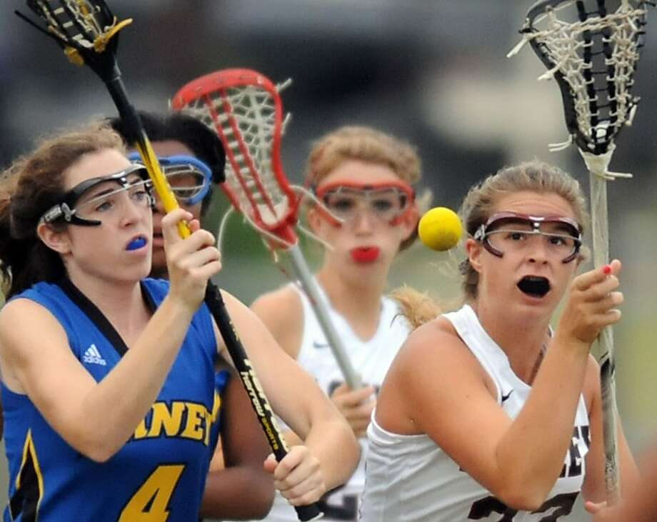 Laney's Molly Lewis, left, competes for possession against Ashley's Peyton LeCompte in a lacrosse playoff game, Friday, May 4, 2012, in Wilmington, N.C. (AP Photo/Wilmington Star-News, Matt Born) Photo: Matt Born, Associated Press
