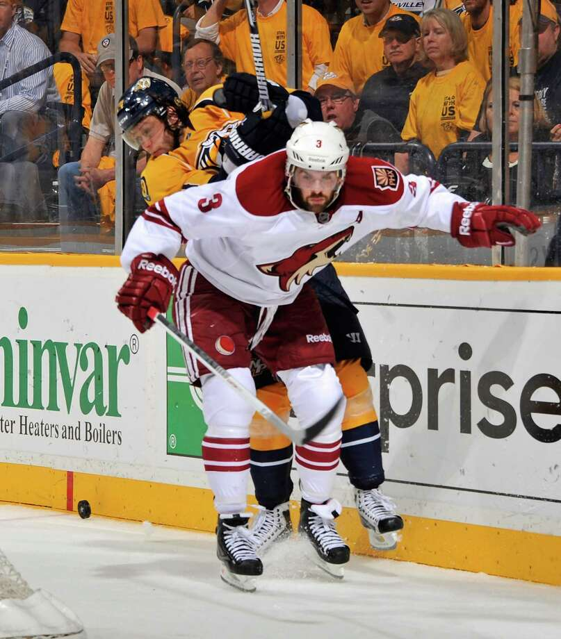 NASHVILLE, TN - MAY 04:  Sergei Kostitsyn #74 of the Nashville Predators collides with Keith Yandle #3 of the Phoenix Coyotes in Game Four of the Western Conference Semifinals during the 2012 NHL Stanley Cup Playoffs at the Bridgestone Arena on May 2, 2012 in Nashville, Tennessee.  (Photo by Frederick Breedon/Getty Images) Photo: Frederick Breedon / 2012 Getty Images
