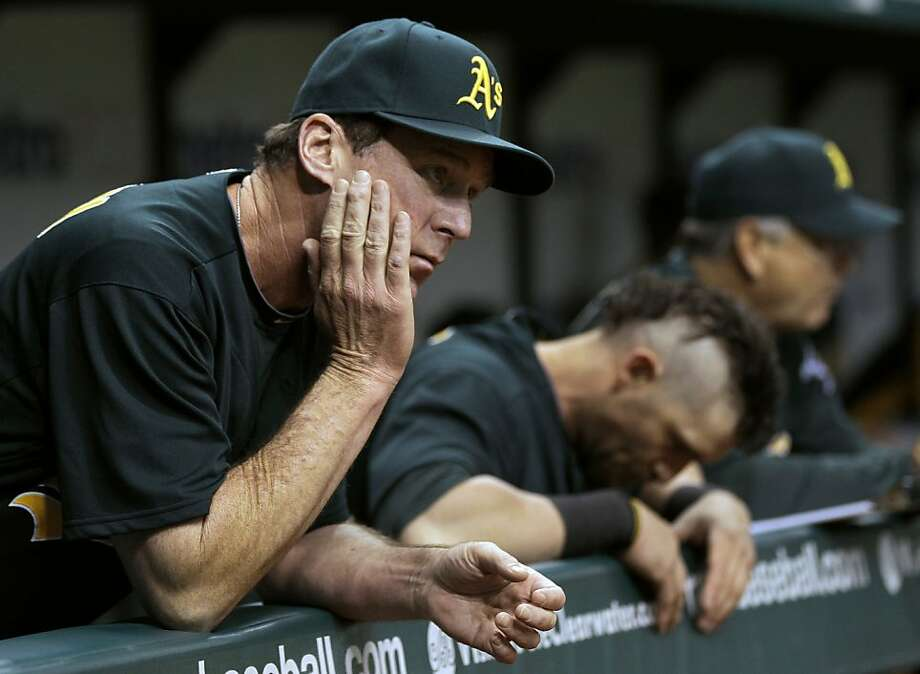 Oakland Athletics manager Bob Melvin, left, and Jonny Gomes react during the first inning of a baseball game against the Tampa Bay Rays, Friday, May 4, 2012, in St. Petersburg, Fla. (AP Photo/Chris O'Meara) Photo: Chris O'Meara, Associated Press