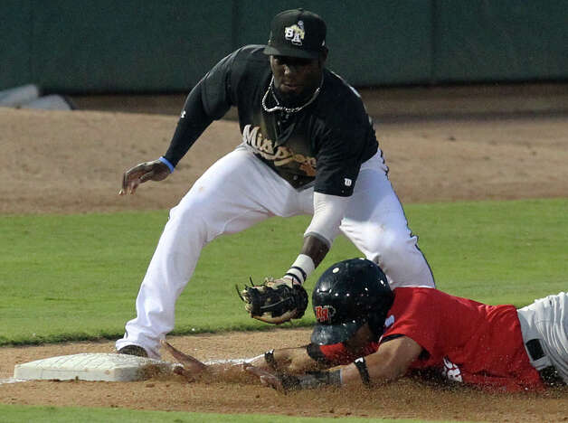 Missions' Edinson Rincon makes the out at third against Frisco Roughriders' Guilder Rodriguez in the fifth inning at Wolff Stadium on Friday, May 4, 2012. Photo: KIN MAN HUI, Kin Man Hui/Express-News / ©2012 San Antonio Express-News