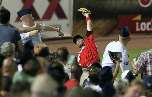 Frisco Roughriders' Ryan Strausborger makes a catch nearby spectators for an out on a foul ball against the Missions in the seventh inning at Wolff Stadium on Friday, May 4, 2012. Photo: KIN MAN HUI, Kin Man Hui/Express-News / ©2012 San Antonio Express-News