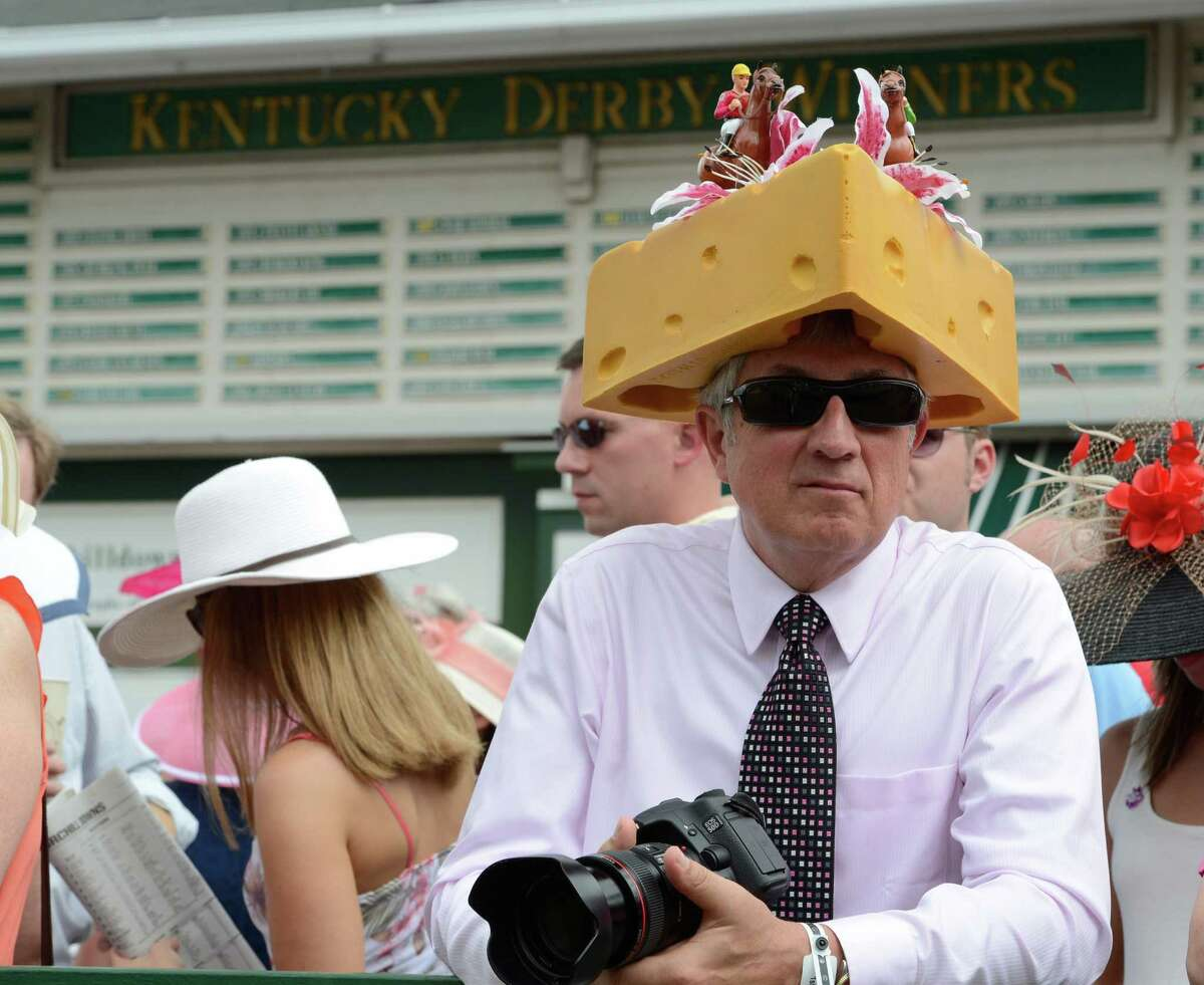 Jim Leuenberger of Shawamo Wis. shows his state pride at Churchill Downs in Louisville, KY. on a day when hats are everywhere on the day before the 138th running of The Kentucky Derby May 4, 2012.(Skip Dickstein / Times Union)