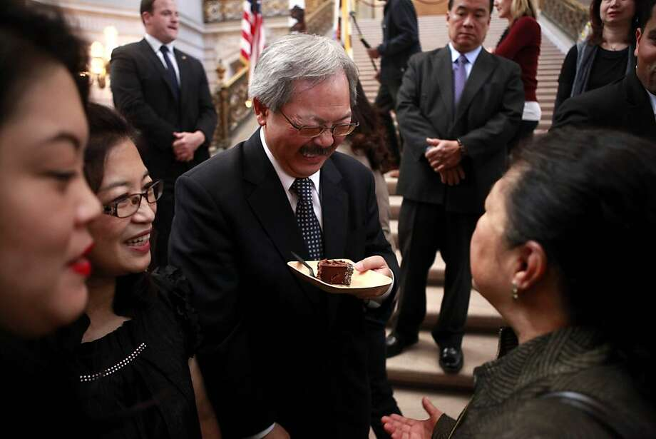 Mayor Ed Lee laughs as he holds the first piece of cake. Mayor Ed Lee turned 60 years old today. A surprise birthday part was held at City Hall in celebration. Photo: Sean Culligan, The Chronicle