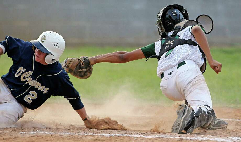 Panther baserunner  Zach Davenport  gets around the tag of catcher Luis Castellanos to score in the third inning as O'Connor beats Southwest 7-4 in high school baseball playoff action at Southwest High School on    May 4, 2012.  Tom Reel/ San Antonio Express-News Photo: TOM REEL, Express-News / San Antonio Express-News