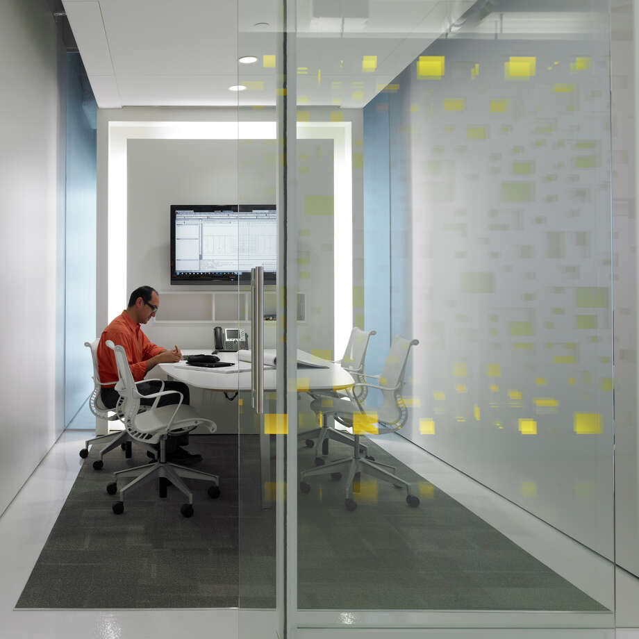 Planning Design Research's bright white space has  yellow accents. And the space is also green all over. Photo: Handout / Scott McDonald © Hedrich Blessing 2011