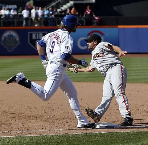 New York Mets' Kirk Nieuwenhuis, left, is safe at first as San Francisco Giants first baseman Aubrey Huff has to step off the base to try for a double play during the ninth inning of a baseball game, Saturday, April 21, 2012, at Citi Field in New York. Because the Giants could not turn the double play, the Mets scored to defeat the Giants 5-4. (AP Photo/Seth Wenig). Photo: Seth Wenig, Associated Press