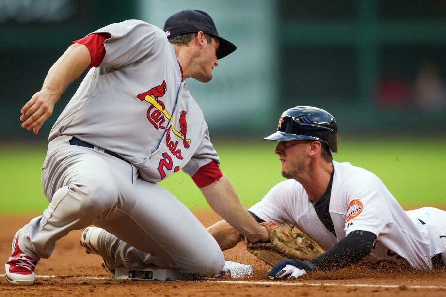 Astros center fielder Jordan Schafer's running, which helped set up an early run, was just one of many bright spots in Friday's win over the Cardinals. Photo: Smiley N. Pool / © 2012  Smiley N. Pool