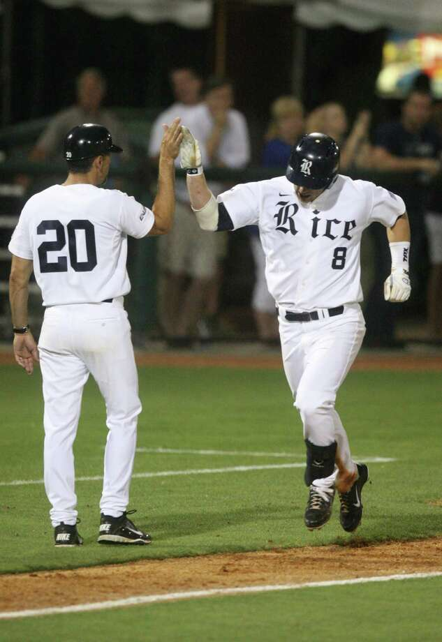 Rice left fielder Michael Ratterree (8) is congratulated by third base coach Patrick Hallmark after hitting a solo home run during the eighth inning against the University of Houston at Reckling Park on Friday, May 4, 2012 in Houston, Texas. Photo: J. Patric Schneider, For The Chronicle / Houston Chronicle