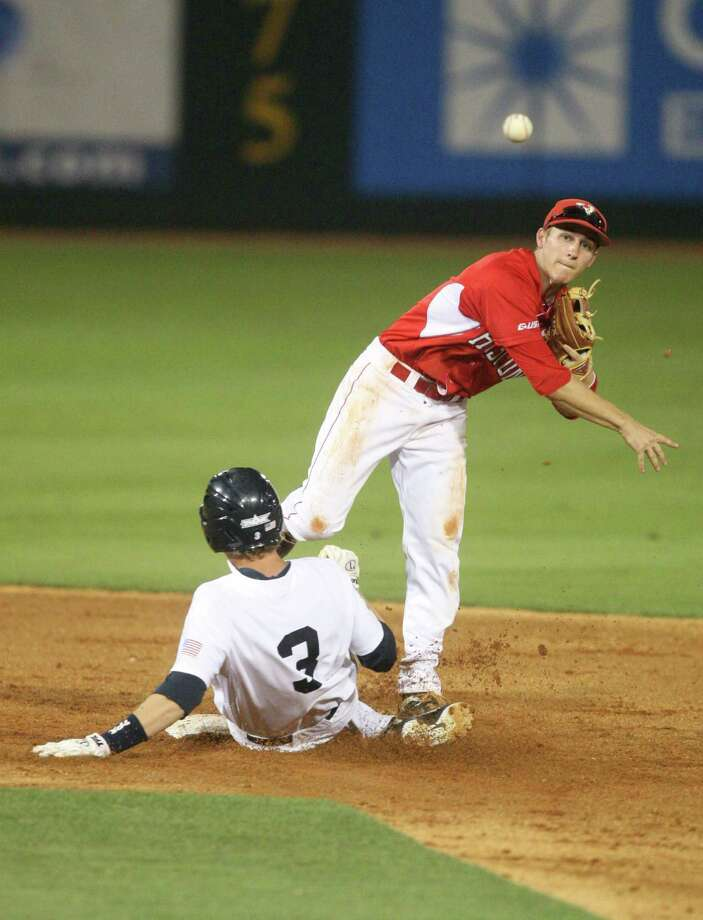 University of Houston Landon Appling (1) turns a double play on Rice  right fielder Jeremy Rathjen (3) during the fifth inning at Reckling Park on Friday, May 4, 2012 in Houston, Texas. Photo: J. Patric Schneider, For The Chronicle / Houston Chronicle