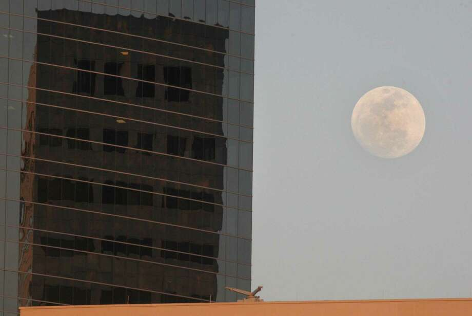 The moon rises over the medical center on Friday, May 4, 2012 in Houston, Texas.   On Saturday night the moon will be the closest to the Earth all year with it being  221,802 miles away.  As a result according to Nasa, the moon will be about 14% bigger and 30% brighter which astronomers call a super moon. Photo: J. Patric Schneider, For The Chronicle / Houston Chronicle