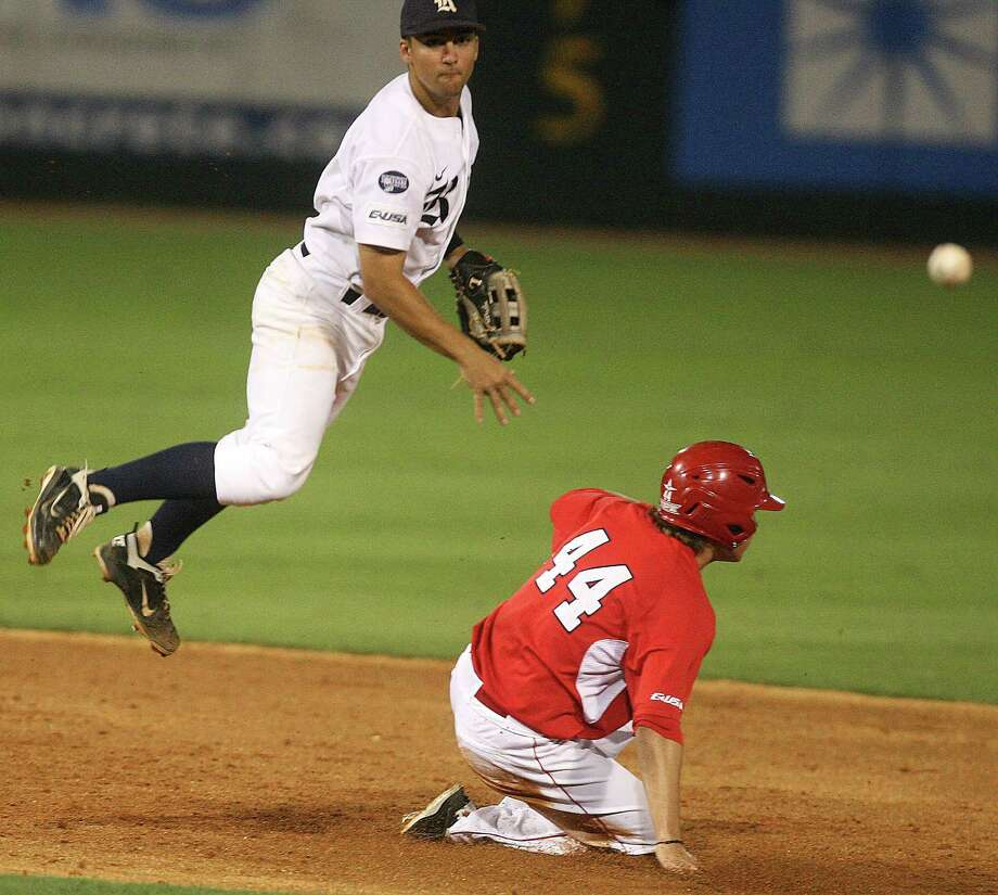 Rice Shortstop Ford Stainback (11) attempts to turn a double play on the University of Houston right fielder Price Jacobs (44) during the sixth inning at Reckling Park on Friday, May 4, 2012 in Houston, Texas. Photo: J. Patric Schneider, For The Chronicle / Houston Chronicle