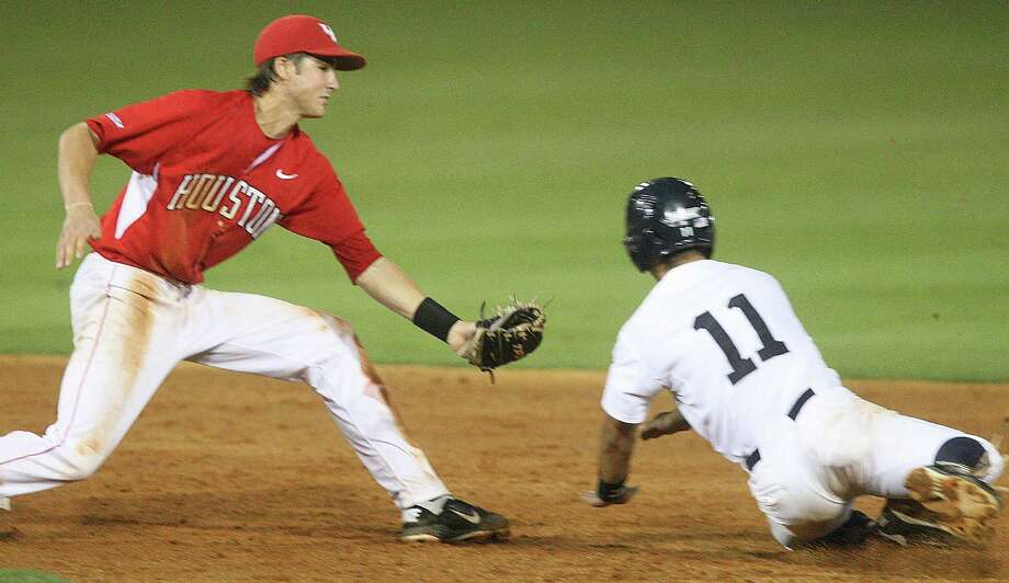 University of Houston shortstop Chase Jensen (17) tags Rice shortstop Ford Stainback (11) out on an attempted steal during the eight inning at Reckling Park on Friday, May 4, 2012 in Houston, Texas. Photo: J. Patric Schneider, For The Chronicle / Houston Chronicle