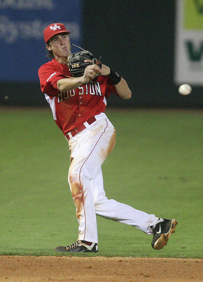 University of Houston shortstop Chase Jensen (17) fields the ball during the ninth inning against Rice at Reckling Park on Friday, May 4, 2012 in Houston, Texas. Photo: J. Patric Schneider, For The Chronicle / Houston Chronicle