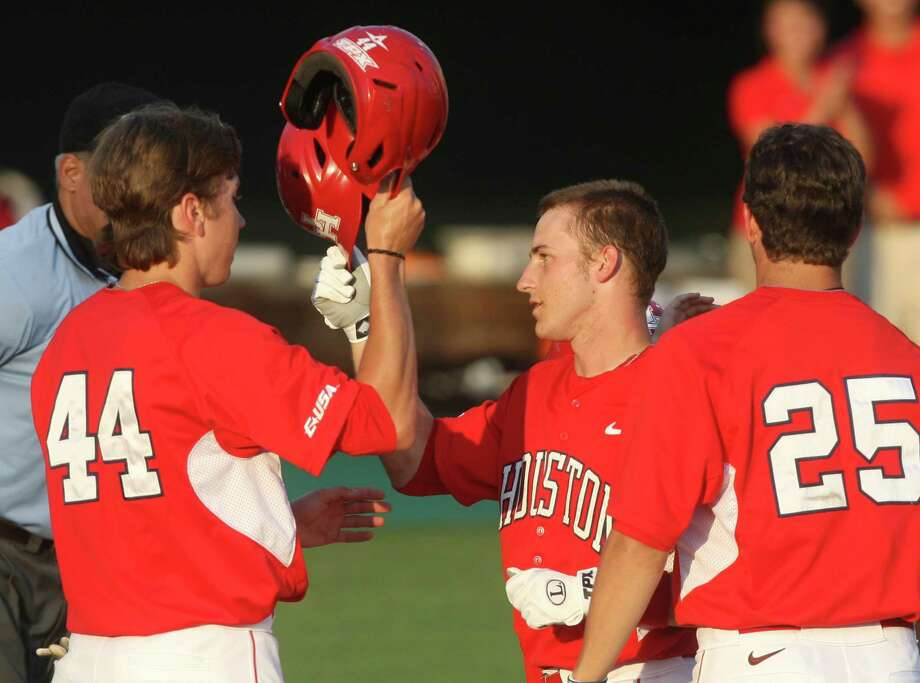 May 4: UH 11, Rice 6 - University of Houston second baseman Landon Appling (1) is congratulated by teammates Price Jacobs (44) and Taylor White (25) after hitting a three run home run during the second inning against Rice at Reckling Park on Friday, May 4, 2012 in Houston, Texas. Photo: J. Patric Schneider, For The Chronicle / Houston Chronicle