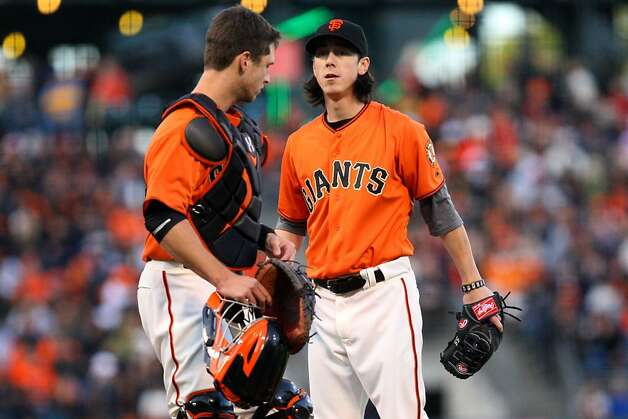 San Francisco Giants catcher Buster Posey, left, talks to pitcher Tim Lincecum after allowing several hits against the Milwaukee Brewers in the 1st inning of the MLB game Friday, May 4, 2012 in San Francisco, Calif. Photo: Erik Verduzco, The Chronicle