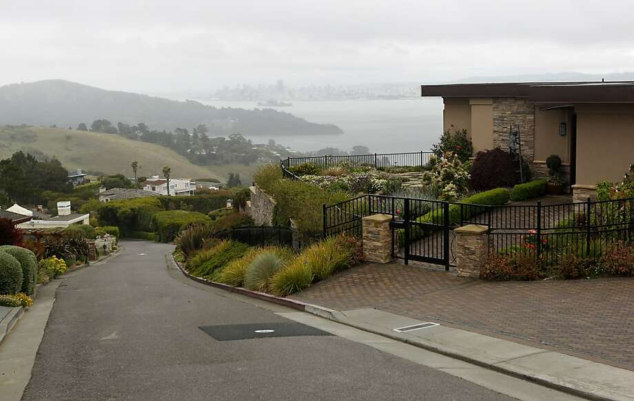 Large homes line Sugarloaf Drive in Tiburon, Calif. on Thursday, May 3, 2012, near a vacant home that teenaged car thief suspect Max Wade broke into a threw a party, according to police investigators. Photo: Paul Chinn, The Chronicle