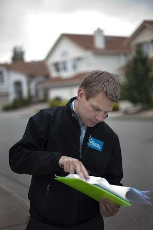 Dublin City Councilman, Eric Swalwell is going door-to-door informing constituents of his campaign to run for Congress on Thursday, May 3, 2012 in Castro Valley, Calif. He carries a list of the specific homes with registered voters he will visit. He has done 15,000 of these visits so far. Today he will visit 35 houses in Castro Valley. Photo: Dania Maxwell, Special To The Chronicle