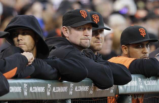 San Francisco Giants first baseman Aubrey Huff, center, watches as the Giants play the Milwaukee Brewers during a baseball game in San Francisco, Friday, May 4, 2012. Huff is encouraged by his progress dealing with anxiety disorder, and believes he will be ready to return to the field for the Giants on Monday when eligible to come off the disabled list. (AP Photo/Jeff Chiu) Photo: Jeff Chiu, Associated Press