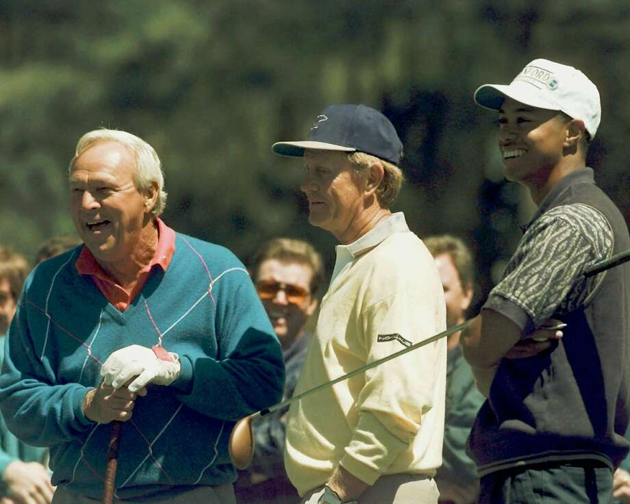 It was a young-looking Tiger Woods sharing a laugh with golf legends Arnold Palmer (left) and Jack Nicklaus in 1996. Woods finds himself out of the world's top 200 for the first time since Sept. 29, 1996. Photo: PHIL SANDLIN, AP / AP