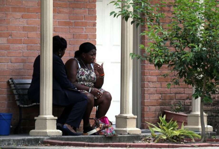 A mother reacts while speaking with HPD Homicide Sgt. Ora Chandler, left, as police investigate the death of her near 6-month-old son who was found in the refrigerator by firefighters where he lived with his father at The University Apartments on the 7100 block of Beechnut Wednesday, May 2, 2012, in Houston.  Investigators say the baby's father called 911 this morning, saying he was suicidal. When rescue personnel arrived at the apartment around 7:40 a.m. no one opened the door. Neighbors told firefighters that a baby was in the apartment. Fearing for the child's safety, firefighters broke into the unit and found the father collapsed on the floor. He was incoherent and said he had killed his son, police said. The baby was found wrapped in a blanket, dead in refrigerator. The father, who has not been identified, became violent and had to be subdued. He was taken to a hospital where he remains. ( Johnny Hanson / Houston Chronicle ) (Houston Chronicle)