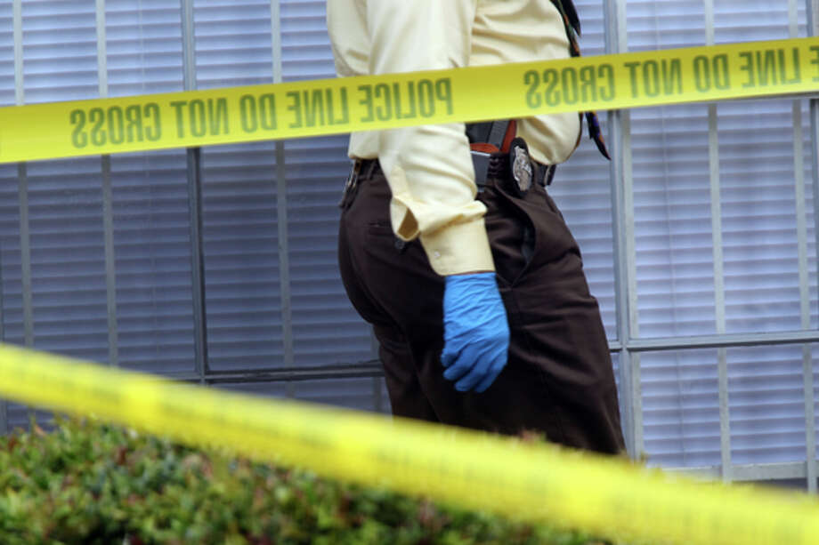 A homicide detective investigates the death of a near 6-month-old boy who was found in the refrigerator by firefighters where he lived with his father at The University Apartments on the 7100 block of Beechnut Wednesday, May 2, 2012, in Houston.  Investigators say the baby's father called 911 this morning, saying he was suicidal. When rescue personnel arrived at the apartment around 7:40 a.m. no one opened the door. Neighbors told firefighters that a baby was in the apartment. Fearing for the child's safety, firefighters broke into the unit and found the father collapsed on the floor. He was incoherent and said he had killed his son, police said. The baby was found wrapped in a blanket, dead in refrigerator. The father, who has not been identified, became violent and had to be subdued. He was taken to a hospital where he remains. ( Johnny Hanson / Houston Chronicle ) Photo: Johnny Hanson, Houston Chronicle / © 2012  Houston Chronicle