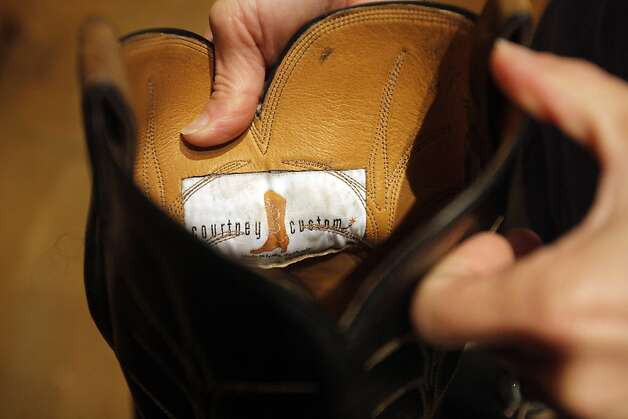 Terri Courtney shows a signature label inside of the boots she makes in her studio in Napa, Calif. on April 24, 2012. Photo: Siana Hristova, The Chronicle