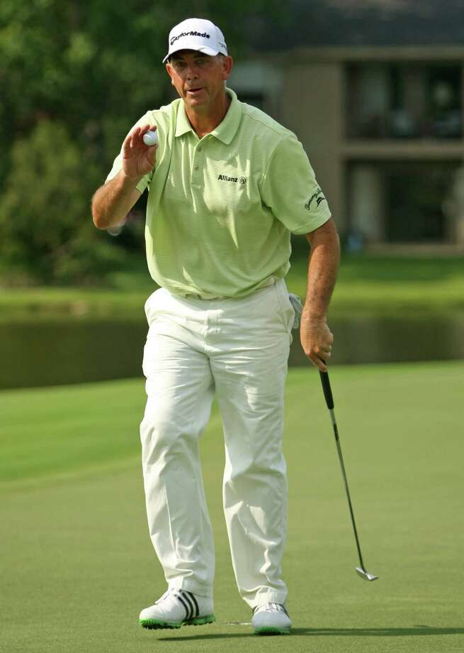 Tom Lehman acknowledges the gallery after his birdie on No. 17 during the first round of the Insperity Championship, Friday, May 4, 2012 at the Tournament Course in The Woodlands, TX. Lehman is the first round leader at 7-under par. Photo: Eric Christian Smith, For The Chronicle