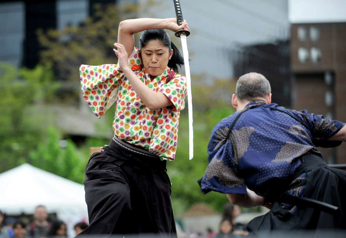 Lisa Itabashi, left, and Sandy Chase, right, perform with Samurai Sword Soul during the Sakura Matsuri Cherry Blossom Festival at Mill River Park on Saturday, May 5, 2012.