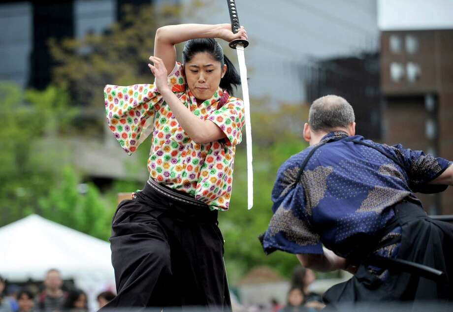 Lisa Itabashi, left, and Sandy Chase, right, perform with Samurai Sword Soul during the Sakura Matsuri Cherry Blossom Festival at Mill River Park on Saturday, May 5, 2012. Photo: Lindsay Niegelberg / Stamford Advocate