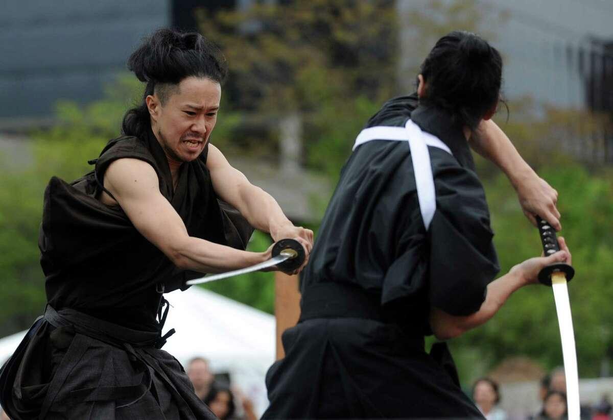 Umihei, left, and Harunobu Sugita, right, perform with Samurai Sword Soul during the Sakura Matsuri Cherry Blossom Festival at Mill River Park on Saturday, May 5, 2012.