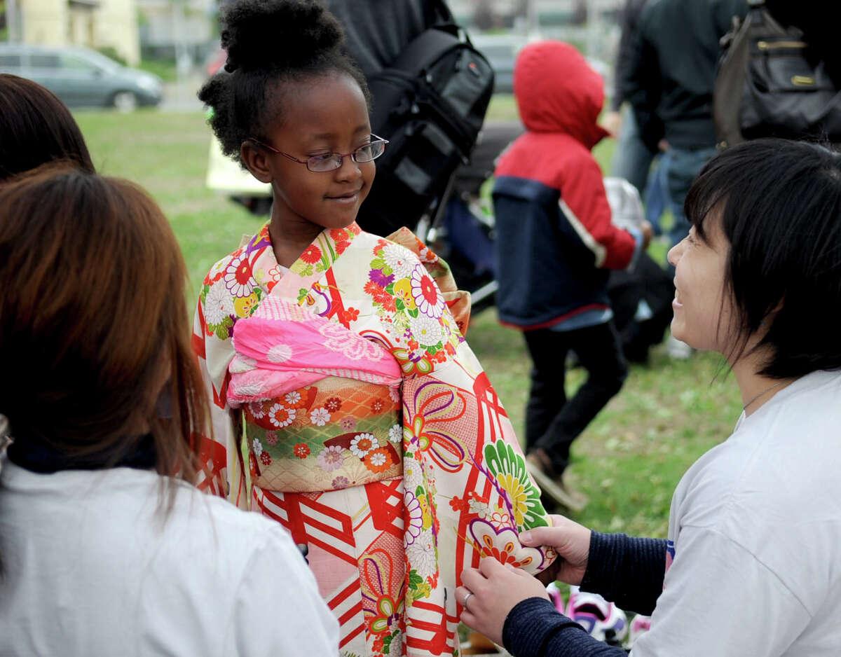 Ava Evans, 5, tries on a kimono during the Sakura Matsuri Cherry Blossom Festival at Mill River Park on Saturday, May 5, 2012.