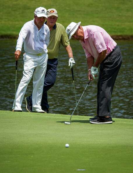Gary Player and Jack Nicklaus watch Arnold Palmer putt on the third hole during the The Insperity Ch