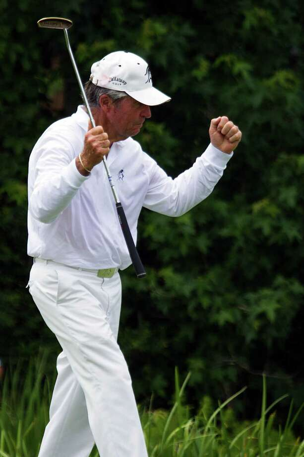 Gary Player celebrates after sinking a putt on the fourth hole during the The Insperity Championship Greats of Golf exhibition. Photo: Smiley N. Pool, Houston Chronicle / © 2012  Smiley N. Pool