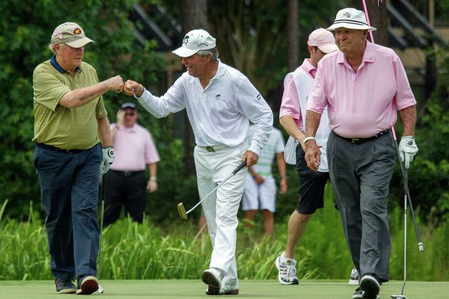 Gary Player, center, celebrates with Jack Nicklaus, left, and Arnold Palmer after sinking a putt on the fourth hole during the The Insperity Championship Greats of Golf exhibition. Photo: Smiley N. Pool, Houston Chronicle / © 2012  Smiley N. Pool