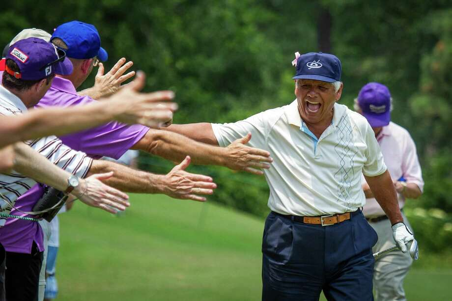 Lee Trevino celebrates with the gallery after hitting his approach shot on the sixth hole. Photo: Smiley N. Pool, Houston Chronicle / © 2012  Smiley N. Pool