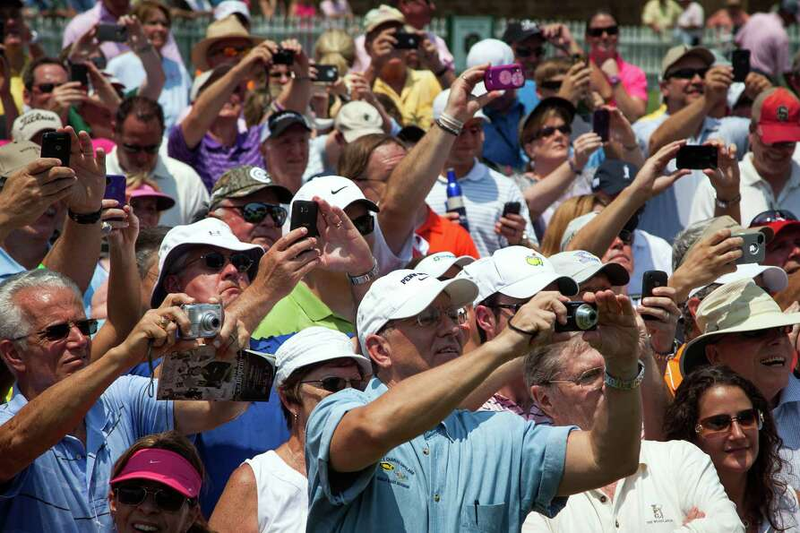 The gallery trains their cameras on the group of Gary Player, Jack Nicklaus and Arnold Palmer during