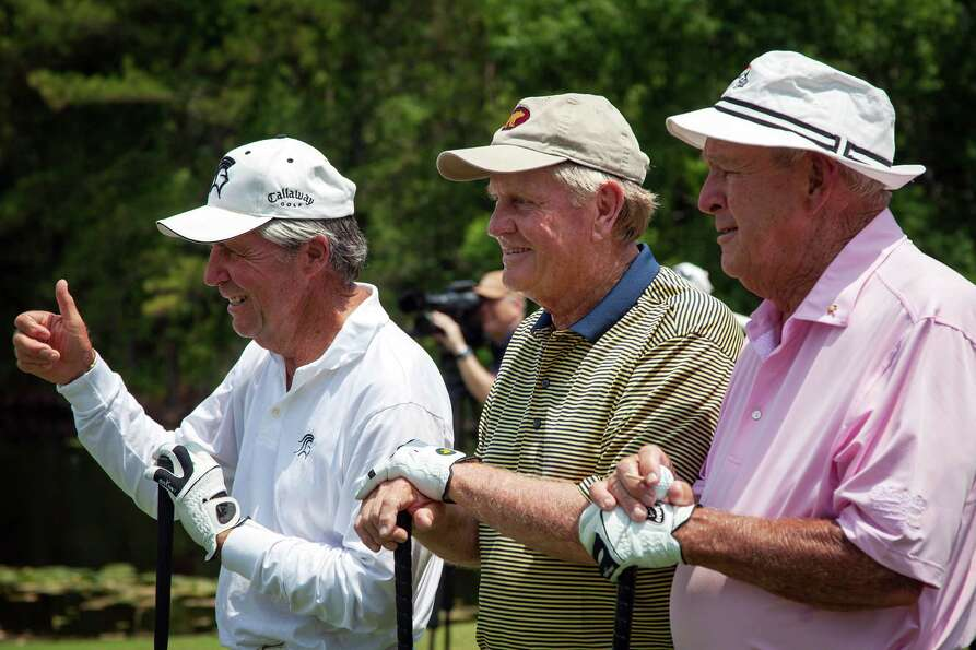 Gary Player, Jack Nicklaus and Arnold Palmer pose for the gallery on the first tee during The Insper