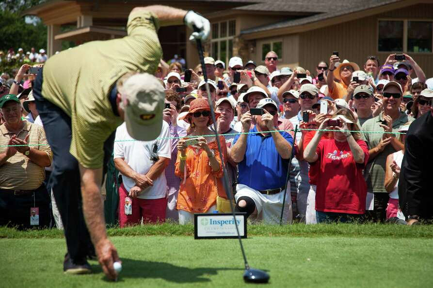 The gallery trains their cameras on Jack Nicklaus as he prepares for his tee shot on the first hole
