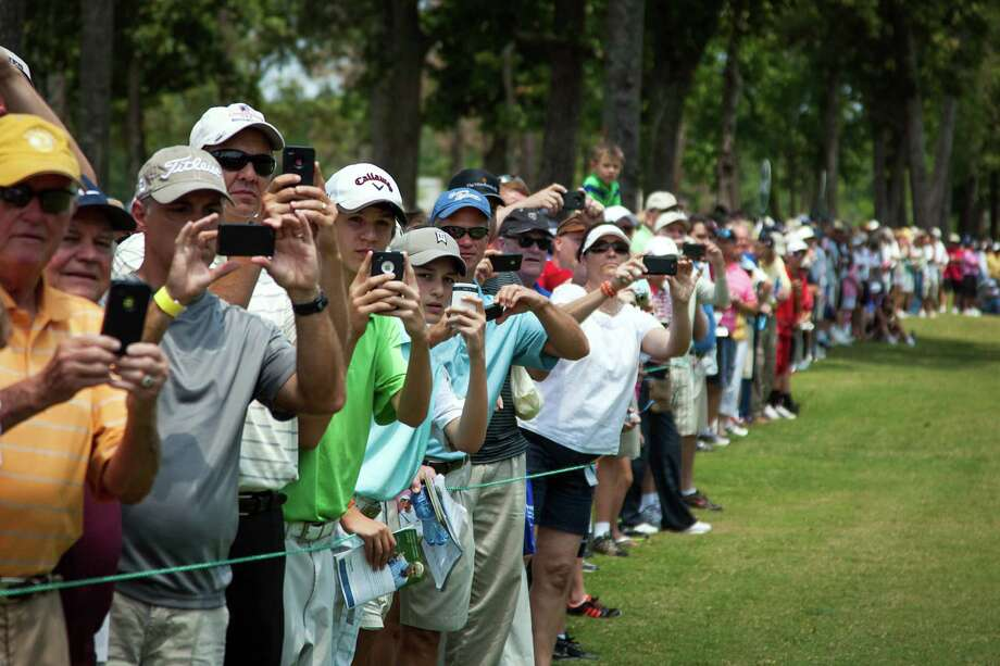 The gallery trains their cameras on the group of Gary Player, Jack Nicklaus and Arnold Palmer during The Insperity Championship Greats of Golf exhibition. Photo: Smiley N. Pool, Houston Chronicle / © 2012  Smiley N. Pool