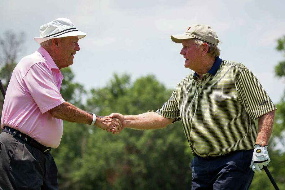 Arnold Palmer, left, congratulates Jack Nicklaus on a shot. Photo: Smiley N. Pool, Houston Chronicle / © 2012  Smiley N. Pool