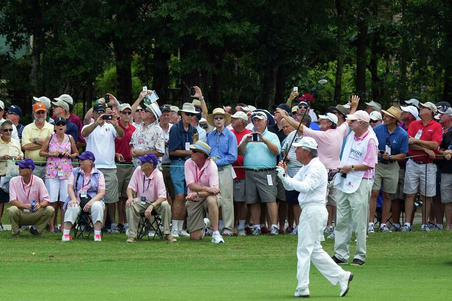 The gallery watches Gary Player make his approach shot on the first hole. Photo: Smiley N. Pool, Houston Chronicle / © 2012  Smiley N. Pool