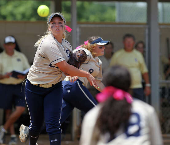 O'Connor pitcher Kenedy Urbany fields a bunt and throws to first for an out in the third inning against Judson in the second round of Class 5A softball playoffs on Saturday, May 5, 2012. O'Connor took the series by winning the first game on Friday and then again on Saturday with a 10-3 win over Judson. Photo: KIN MAN HUI, Kin Man Hui/Express-News / ©2012 San Antonio Express-News